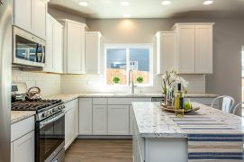 What's cookin'? A fabulous kitchen!... Quartz counter-tops, dining-island, ample storage space, & all stainless steel appliances stay...