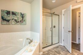 Master bath with corner soaking tub (comes standard) & shower...